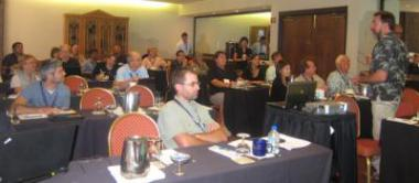 Conference attendees listening to a workshop presenter